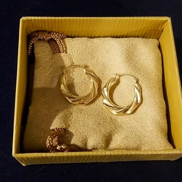 JTV 10k Yellow Gold Twisted Tube Hoop Earrings